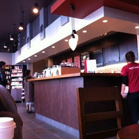 Photo taken at Starbucks by Jun A. on 12/11/2011