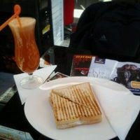 Photo taken at Cafe Downtown by Emrah B. on 11/12/2011