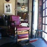 Photo taken at Graceland Hair & Tattoo by JKR J. on 8/12/2011