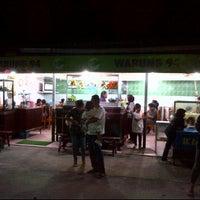 Photo taken at Warung 94 Belakang Kantor Pos by Yulianus L. on 1/9/2012