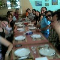Foto tomada en Pizzería TV por Vanesa R. el 12/29/2011