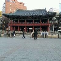 Photo taken at Bosingak by Jinyoung P. on 1/29/2012