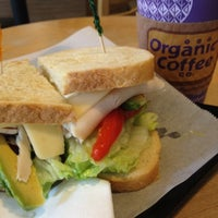 Photo taken at Organic Coffee Co. by Lee O. on 8/14/2012