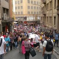 Photo taken at Rua 25 de Março by DanySabadini on 1/8/2012
