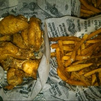 Photo taken at Wingstop by Grisel D. on 7/28/2012