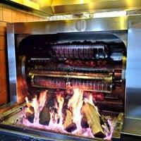 Photo taken at The Smokin' Oak Rotisserie & Grill by Joe W. on 3/31/2012