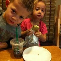 Photo taken at Starbucks by Naomi T. on 11/18/2011