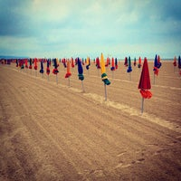 Photo taken at Plage de Deauville by Vladimir K. on 7/9/2012