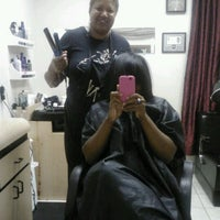 Photo taken at Eclectic Beauty Salon/School by Ivery R. on 8/16/2012