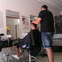 Photo taken at Buen Pello Hair Studio by Desimir P. on 6/8/2012