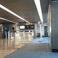 Photo taken at Gate H17 by Tiff P. on 6/21/2012