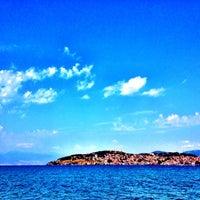Photo taken at Kadmo Beach by Stefan Cece on 8/13/2012
