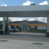 Photo taken at Mobil by Peter B. on 3/29/2012