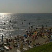 Photo taken at Plaja Neptun by Andrei A. on 8/24/2012