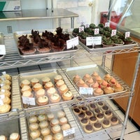 Photo taken at Kickass Cupcakes by Trevor F. on 6/19/2012