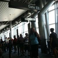 Photo taken at Gate E8 by Richard S. on 6/30/2012