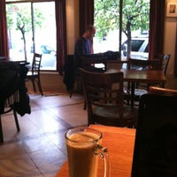 Photo taken at Espresso Roma Cafe by Kate S. on 1/19/2012