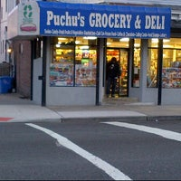Photo taken at Puchu's Grocery and Deli by RAY21 L. on 1/18/2012