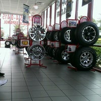 Photo taken at Discount Tire® Store by Jyl D. on 7/23/2012
