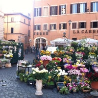 Photo taken at Campo de' Fiori by Ivy T. on 5/29/2012
