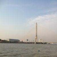 Photo taken at Santichai Prakan Park by Rinny C. on 3/16/2012