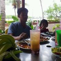 Photo taken at Warung Nasi Kuning by Mohammad N. on 3/11/2012