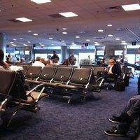 Photo taken at Gate D60 by Ana K. on 1/21/2012