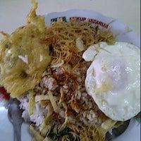 Photo taken at Warung Nasi Surya by sandi w. on 1/5/2012