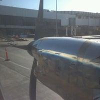 Photo taken at Terminal 7 by Rei B. on 12/3/2011