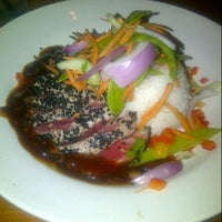 Photo taken at Flame Rotisserie Grill & Bar by Weber Ress on 8/31/2012