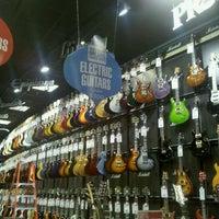Photo taken at Guitar Center by Sara M. on 12/23/2011