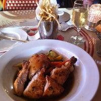 Photo taken at Monsieur Marcel Gourmet Market by Mary Ann G. on 7/22/2011