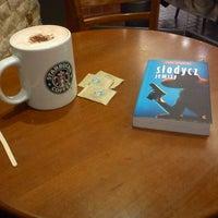Photo taken at Starbucks by Michał S. on 1/14/2012