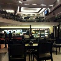 Foto tomada en Sócrates Cafe por Alejandro M. el 6/5/2012