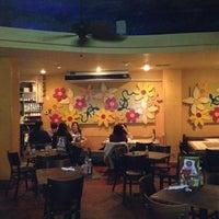 Photo taken at Johnny Mango World Café & Bar by Dana R. on 10/18/2011