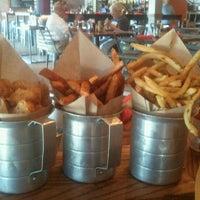Photo taken at BRGR Kitchen + Bar by Genevieve on 8/21/2011