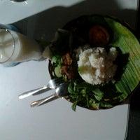 Photo taken at Resto Kampoeng by Taufik D. on 8/1/2012