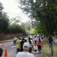 Photo taken at Ciclovía Avenida El Poblado by Jesse L. on 7/8/2012