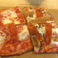 Photo taken at Jules Thin Crust Pizza by Malcolm G. on 8/20/2012