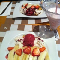 Photo taken at Crepes & Waffles by Romm C. on 7/28/2012