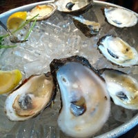 Photo taken at Pappadeaux Seafood Kitchen by Denene on 7/14/2012