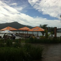 Photo taken at Ponta das Caranhas by Eddu F. on 1/2/2012