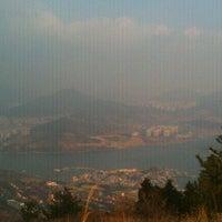 Photo taken at 안심산정상 by Sara P. on 1/1/2012