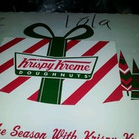 Photo taken at Krispy Kreme by Fabiola N. on 12/26/2011