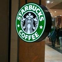 Photo taken at Starbucks Coffee by Tiago S. on 7/8/2012