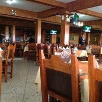 Photo taken at Restaurant El Tiuna by Carlos M. on 3/28/2012
