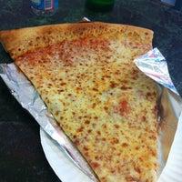 Photo taken at Jumbo Slice Pizza by Jason D. on 7/4/2012