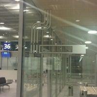 Photo taken at Gate 50 by Pekka V. on 3/2/2011