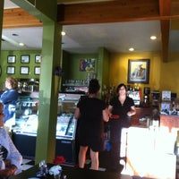 Photo taken at Toni's Courtyard Cafe by Andy C. on 7/23/2011