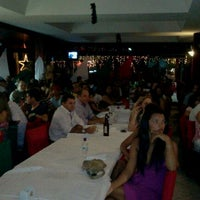Photo taken at Churrascaria Gaúcha by Erytréia U. on 12/9/2011